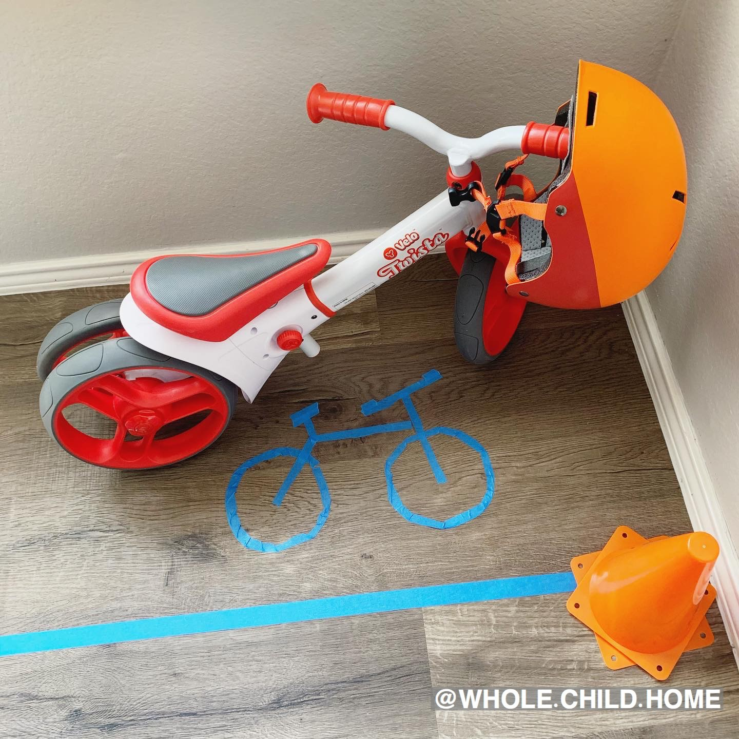Montessori at Home, prepared environment adapts, indoor bike parking with painter's tape