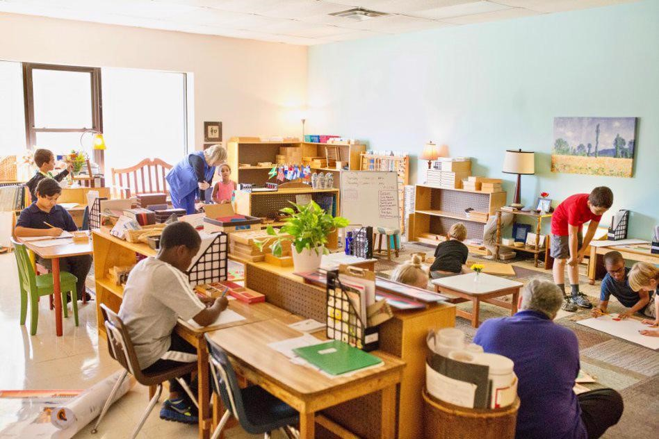 children working in a montessori elementary classroom at Guidepost Montessori